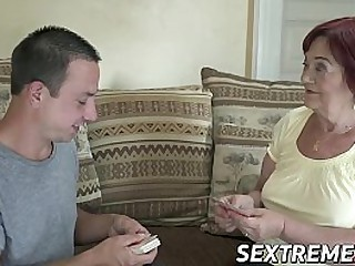 Busty redhead granny rides a young guy