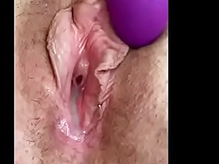Granny loves to toy her creamy cunt with her favorite vibrator mature senior masturbating